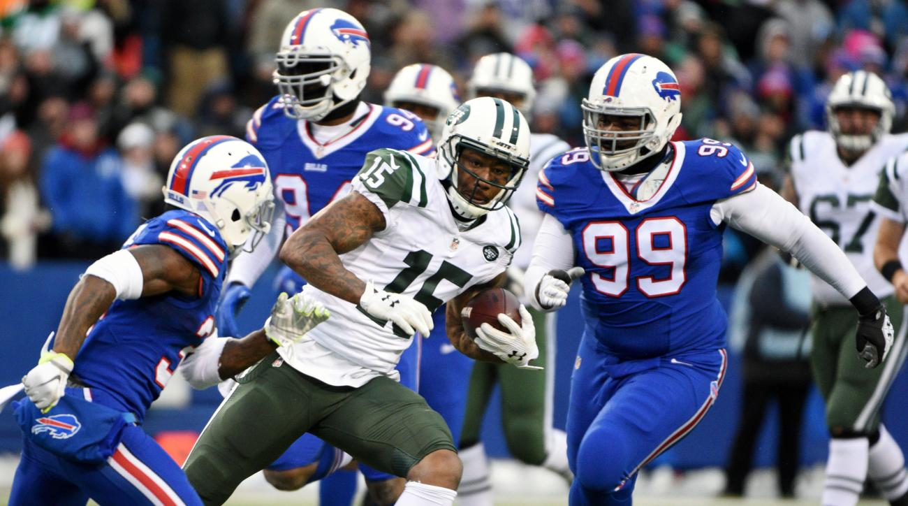 FILE - In this Sunday, Jan. 3, 2016 file photo, New York Jets wide receiver Brandon Marshall (15) draws a crowd of Buffalo Bills during the second half of an NFL football game in Orchard Park, N.Y. A civil trial over a California womans claim that she was