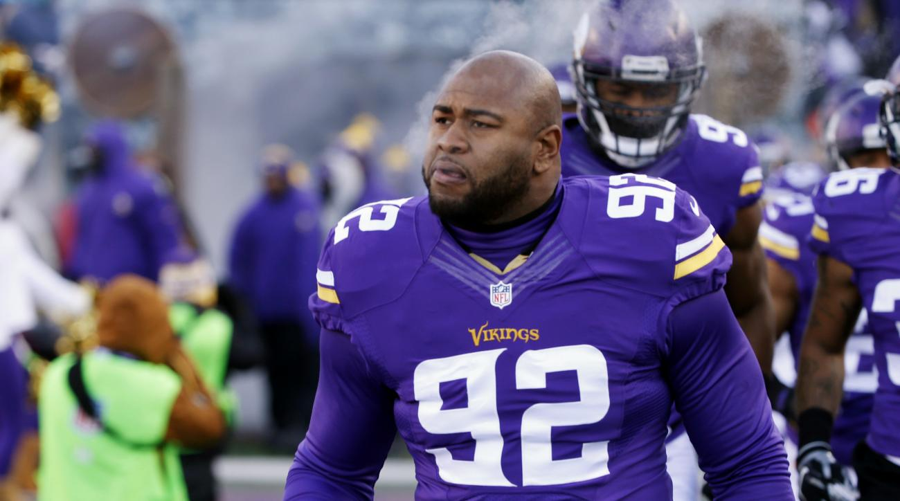 FILE - In this Jan. 10, 2016, file photo, Minnesota Vikings defensive tackle Tom Johnson is introduced before an NFL football game against the Seattle Seahawks in Minneapolis. In a lawsuit filed in federal court last Friday, April 1, 2016, Johnson is suin