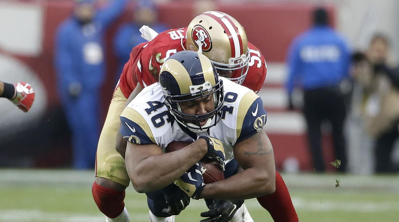 St. Louis Rams tight end Cory Harkey (46) is tackled by San Francisco 49ers middle linebacker Gerald Hodges (51) during the second half of an NFL football game in Santa Clara, Calif., Sunday, Jan. 3, 2016. (AP Photo/Marcio Jose Sanchez)