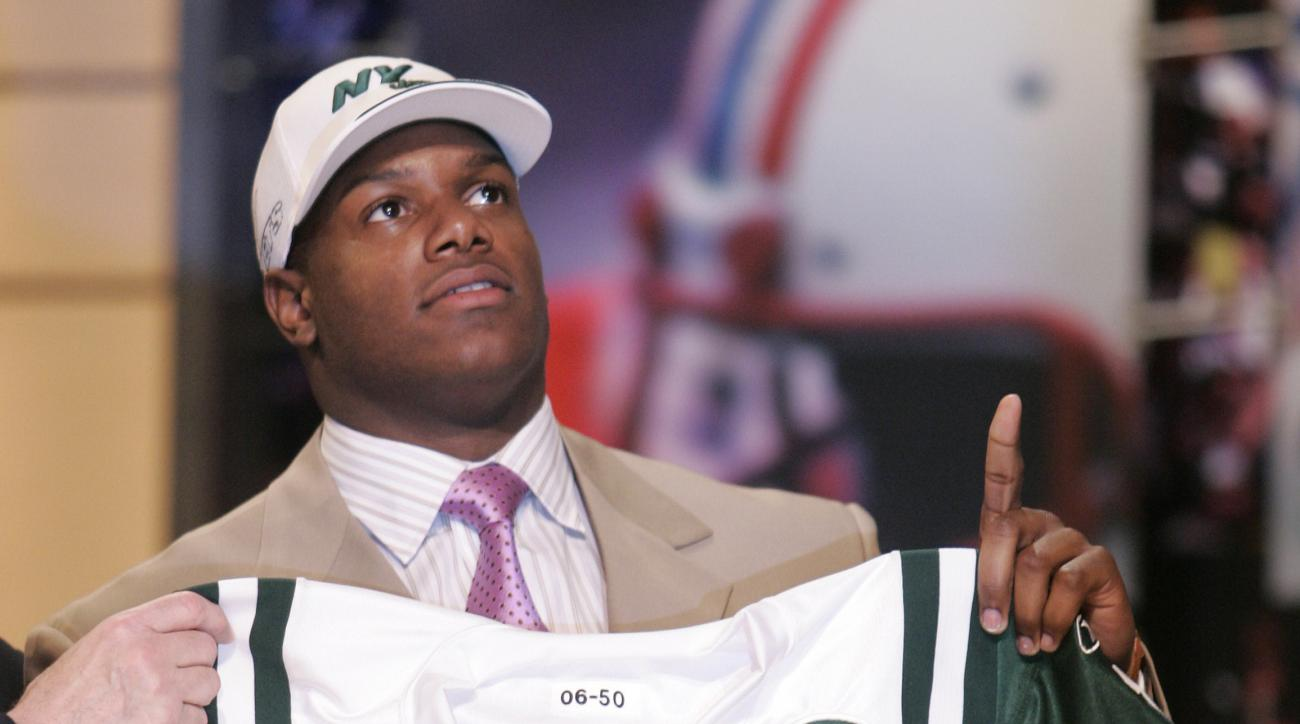 FILE - In this April 29, 2006, file photo, D'Brickashaw Ferguson, offensive tackle from Virginia, holds up a New York Jets jersey after being selected by Jets in the first round, fourth overall, in the NFL Draft at Radio City Music Hall in New York. Fergu