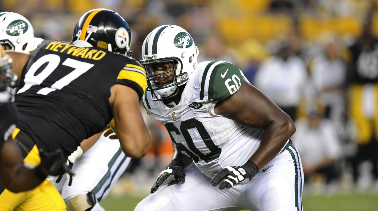 FILE - In this Sept. 16, 2012, file photo, New York Jets tackle D'Brickashaw Ferguson (60) looks to block Pittsburgh Steelers defensive end Cameron Heyward (97) during the fourth quarter of an NFL football game, in Pittsburgh. Ferguson is walking away fro