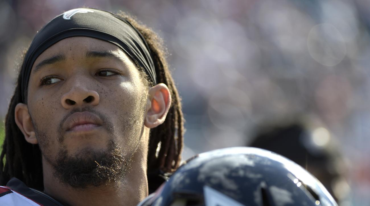 Atlanta Falcons cornerback Jalen Collins (32) watches from the sideline before an NFL football game against the Jacksonville Jaguars in Jacksonville, Fla., Sunday, Dec. 20, 2015. (AP Photo/Phelan M. Ebenhack)