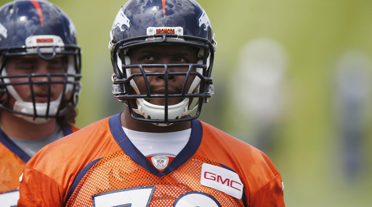 FILE - In this May 27, 2015, file photo, Denver Broncos offensive tackle Ryan Clady waits to take part in drills during an NFL football organized team activity at the team's headquarters in Englewood, Colo. A person familiar with the deal tells The Associ