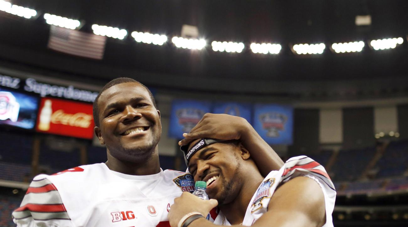 FILE - In this Dec. 30, 2014, file photo, Ohio State quarterback Cardale Jones, left, hugs safety Tyvis Powell, right as they walk off the field after media day for the Sugar Bowl NCAA college football game at the Mercedes-Benz Superdome in New Orleans. P