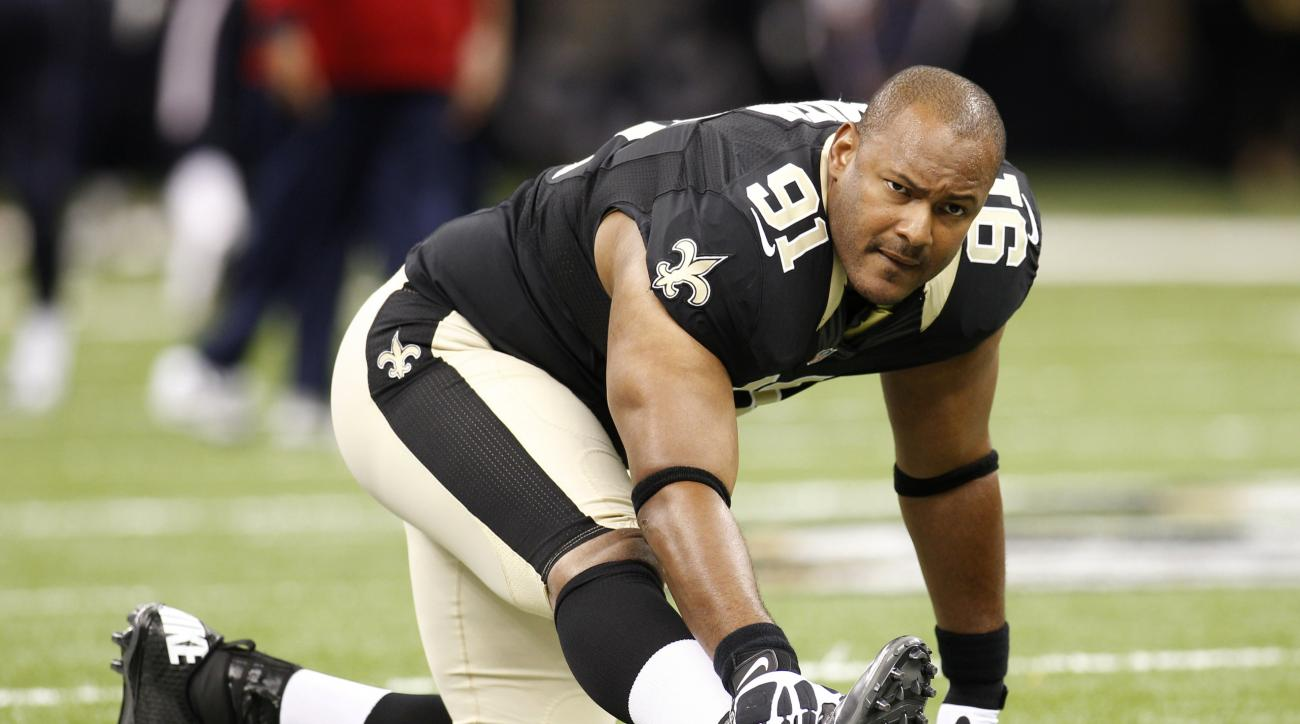 FILE - In this Aug. 25, 2012, file photo, New Orleans Saints defensive end Will Smith stretches before a preseason NFL football game in New Orleans. An attorney for the family of Smith said Wednesday, April 13, 2016, that the former Saints star did not br