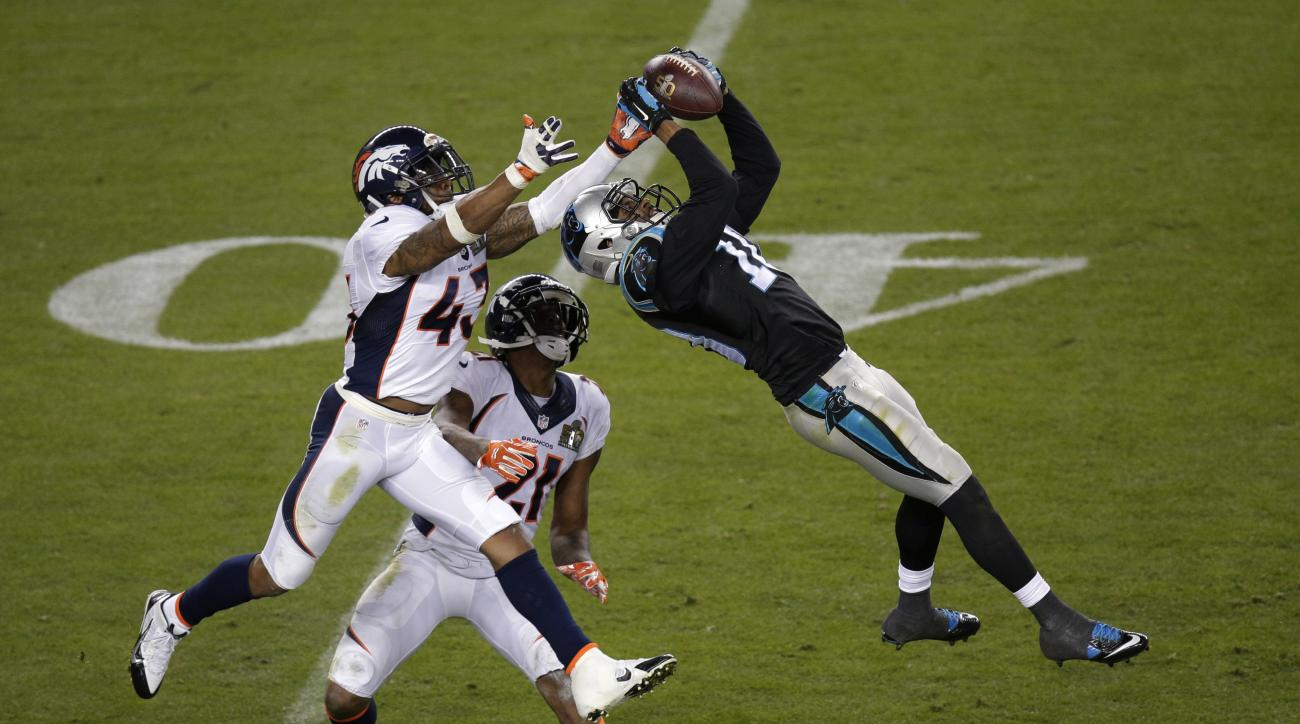 FILE - In this Feb. 7, 2016, file photo, Carolina Panthers Corey Brown (10) catches a pass in front of Denver Broncos T.J. Ward (43) and Aqib Talib (21) during the NFL Super Bowl 50 football game in Santa Clara, Calif. The NFL season will begin the way th