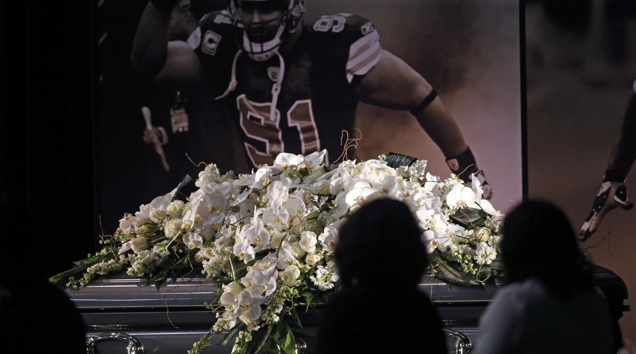 People view the casket of New Orleans Saints defensive end Will Smith during a public viewing at the NFL football team's training facility in Metairie, La., Friday, April 15, 2016. Smith was shot to death last Saturday, and his wife wounded by gunfire, af