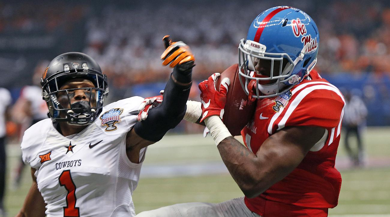 FILE - In this Jan. 1, 2016, file photo, Mississippi wide receiver Laquon Treadwell, right, pulls in a touchdown reception in front of Oklahoma State cornerback Kevin Peterson (1) during the first half of the Sugar Bowl NCAA college football game in New O