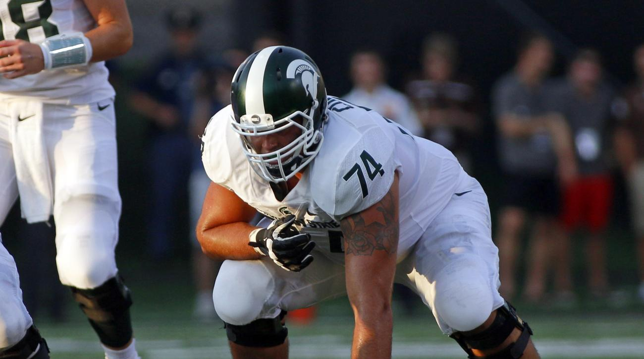 FILE - In this Sept. 4, 2015 file photo, Michigan State offensive lineman Jack Conklin (74) gets set at the line of scrimmage during the first quarter of an NCAA college football game  against Western Michiganin Kalamazoo, Mich. Conklin is one of the top