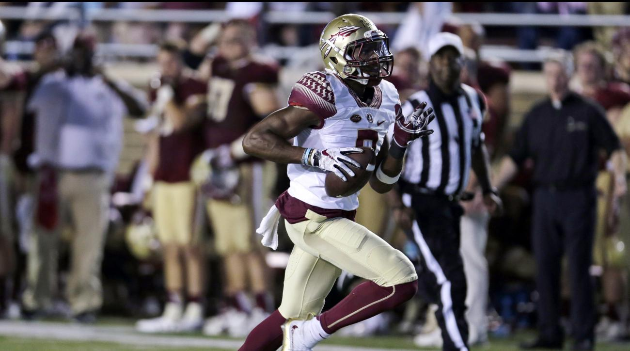 FILE - In this Sept. 18, 2015, file photo, Florida State defensive back Jalen Ramsey (8) runs back the ball for a touchdown during the second half of an NCAA college football game in Boston. Ramsey is one of the top defensive players available in the NFL