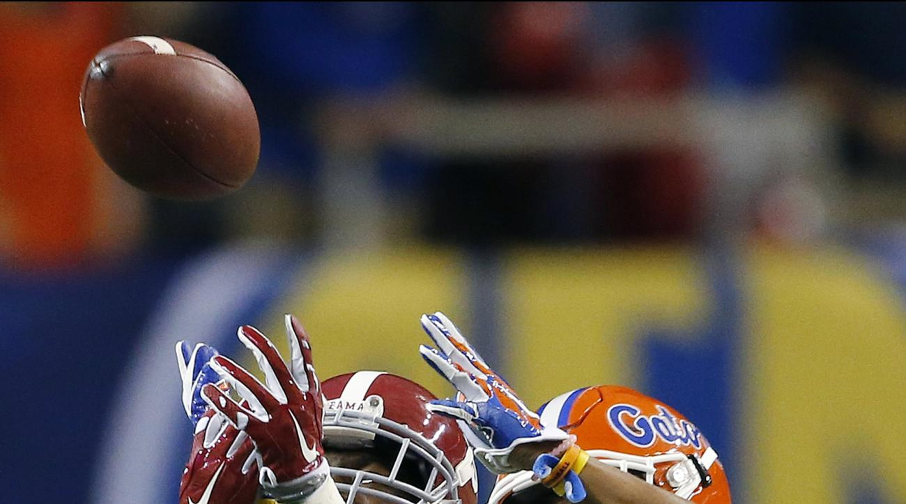FILE - In this Dec. 5, 2015, file photo, Alabama wide receiver Calvin Ridley (3) and Florida defensive back Vernon Hargreaves III (1) battle for a pass during the first half of the Southeastern Conference championship NCAA college football game in Atlanta