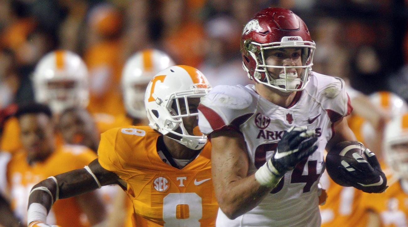 FILE - In this Oct. 3, 2015, file photo, Arkansas tight end Hunter Henry (84) outruns Tennessee defensive back Justin Martin (8) during the second half of an NCAA college football game, in Knoxville, Tenn. Henry is one of the top offensive players availab
