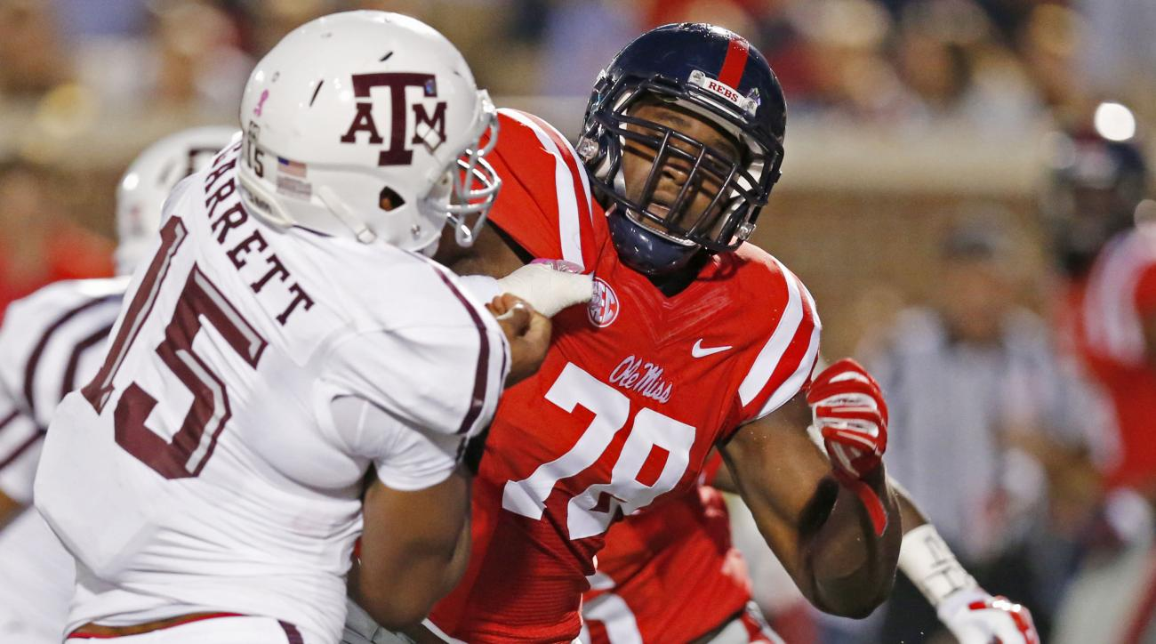 FILE - In this Oct. 24, 2015, file photo, Texas A&M defensive lineman Myles Garrett (15) is blocked by Mississippi offensive lineman Laremy Tunsil (78) during the first half of their NCAA college football game in Oxford, Miss. Tunsil is one of the top off