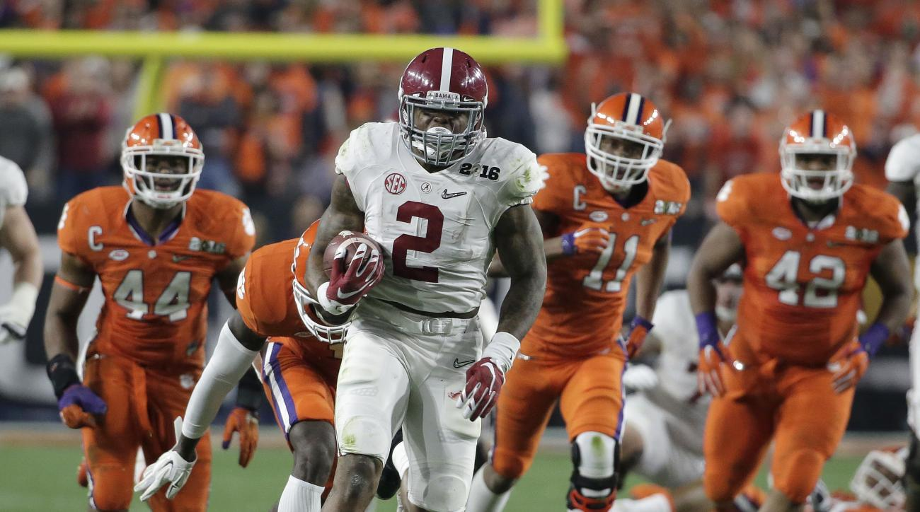 FILE - In this Jan. 11, 2016, file photo, Alabama's Derrick Henry runs for a touchdown during the first half of the NCAA college football playoff championship game against Clemson in Glendale, Ariz. Henry is one of the top offensive players available in t