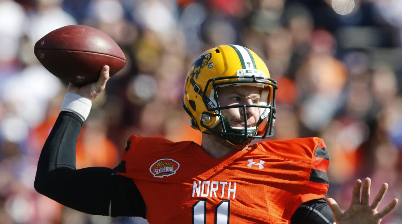 FILE - In this Jan. 30, 2016, file photo, North Dakota State quarterback Carson Wentz throws a pass during the Senior Bowl NCAA college football game at LaddPeebles Stadium, in Mobile, Ala. The Philadelphia Eagles acquired the No. 2 overall pick in next w