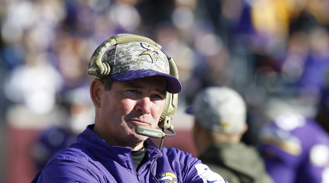 FILE - In this Nov. 8, 2015, file photo, Minnesota Vikings head coach Mike Zimmer looks on before the second half of an NFL football game against the St. Louis Rams, in Minneapolis. The Vikings have the 23rd pick in the first round in next week's NFL draf
