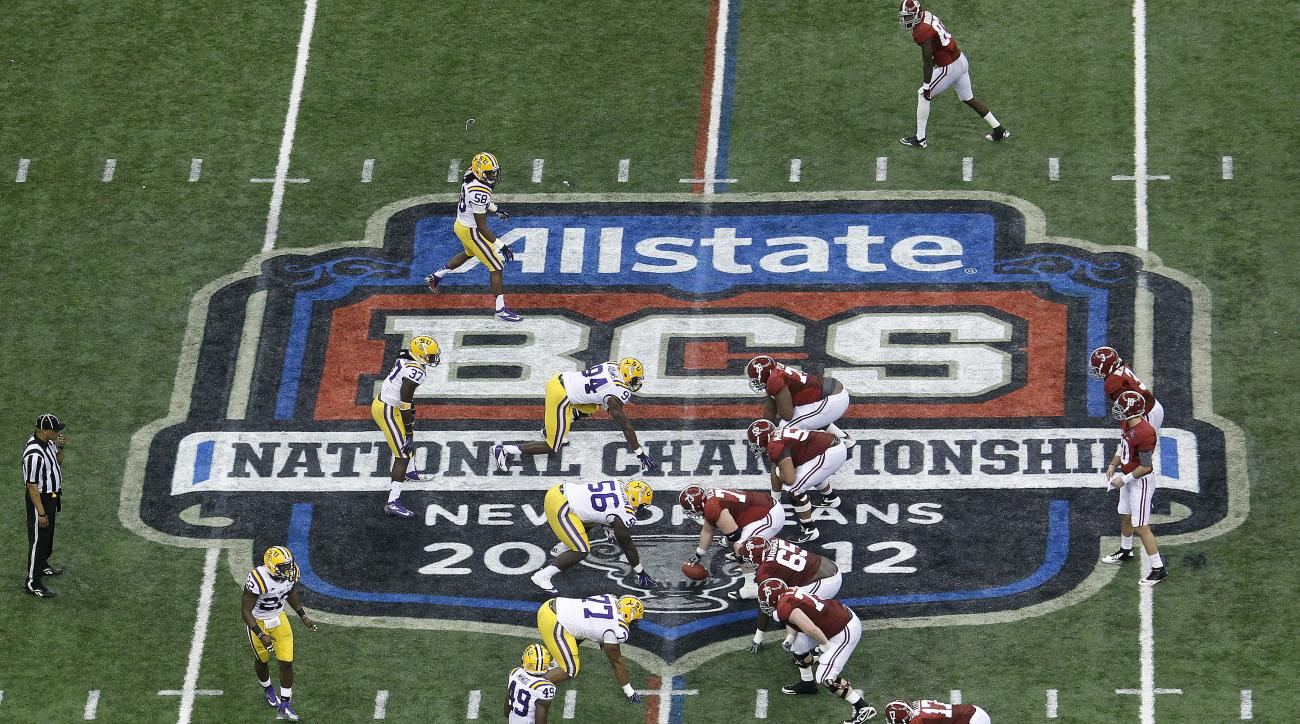 FILE - In this Jan. 9, 2012, file photo, Alabama, right, prepares to snap the ball against LSU during the first half of the BCS National Championship college football game in New Orleans. The way the spread offense has, well, spread throughout college foo
