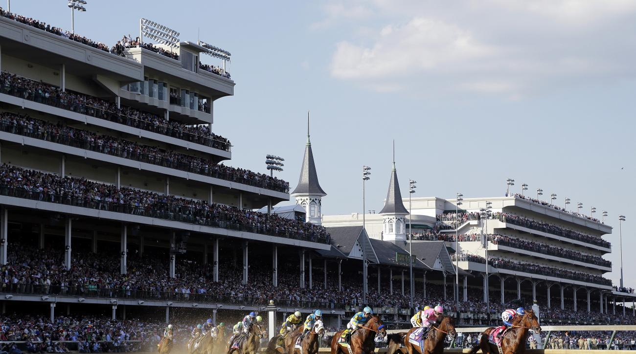 FILE - In this May, 2, 2015, file photo, horses make their way around turn one during the 141st running of the Kentucky Derby horse race at Churchill Downs in Louisville, Ky. American Pharoah (18), fourth from right, won the race. William Shakespeare died