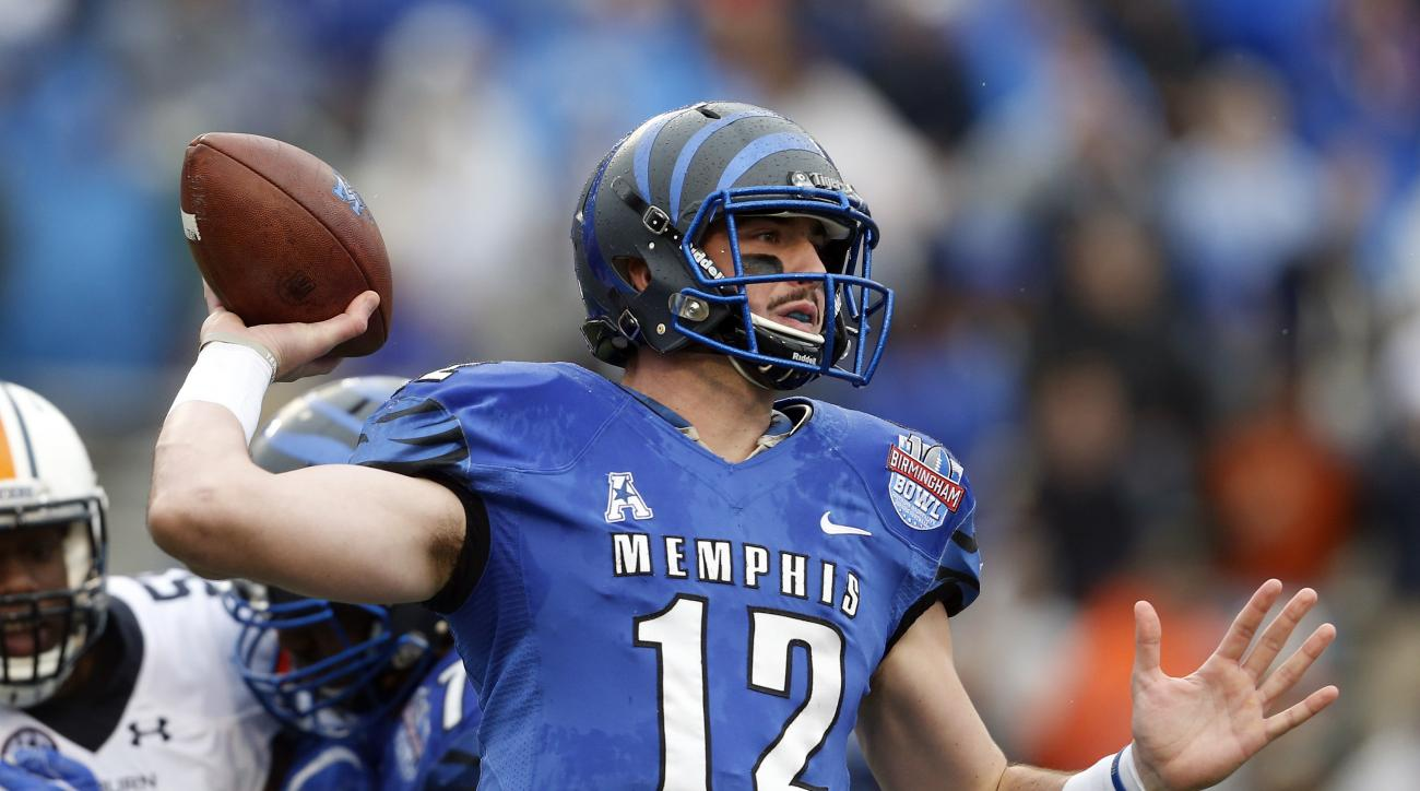 FILE - In this Dec. 30, 2015, file photo, Memphis quarterback Paxton Lynch (12) throws a pass during the first half of the Birmingham Bowl NCAA college football game against Auburn  in Birmingham, Ala. The way the spread offense has taken over college foo