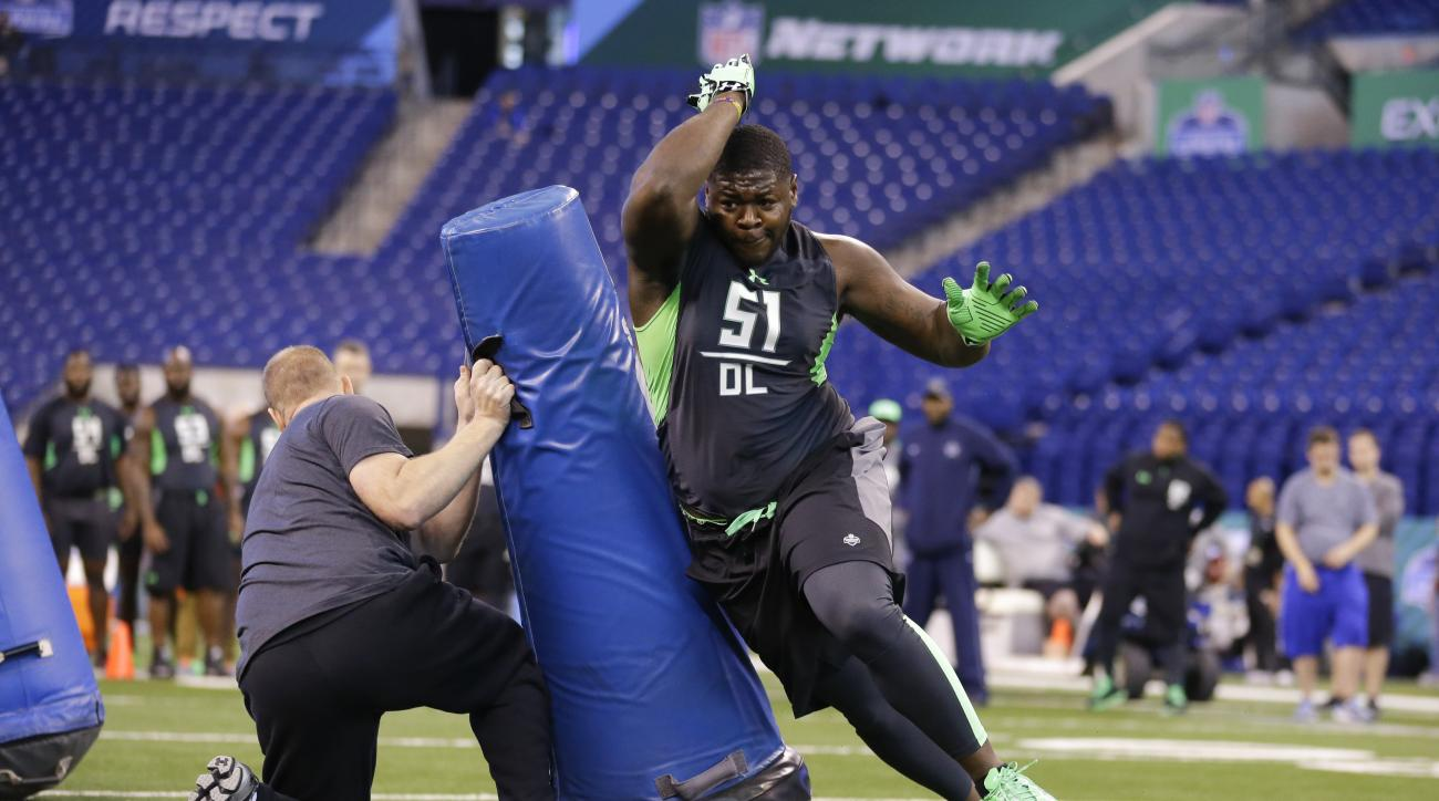 FILE - In this Feb. 28, 2016, file photo, Alabama defensive lineman Jarran Reed runs a drill at the NFL football scouting combine in Indianapolis. Two people familiar with the plans have told The Associated Press that Buffalo Bills officials are visiting