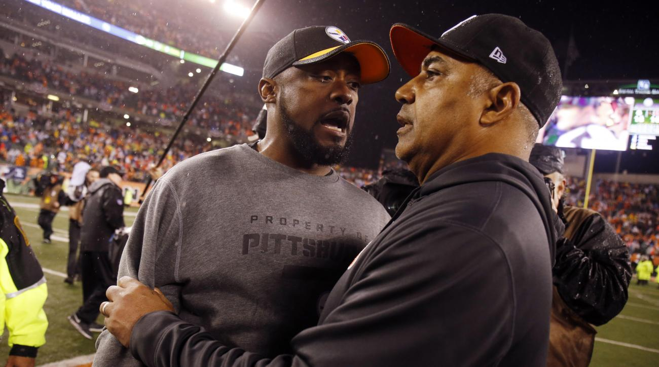 FILE - In this Jan. 10, 2016 file photo, Pittsburgh Steelers head coach Mike Tomlin talks with Cincinnati Bengals head coach Marvin Lewis following an NFL wild-card playoff football game, in Cincinnati. All of this Steelers-and-Bengals animosity isnt goin