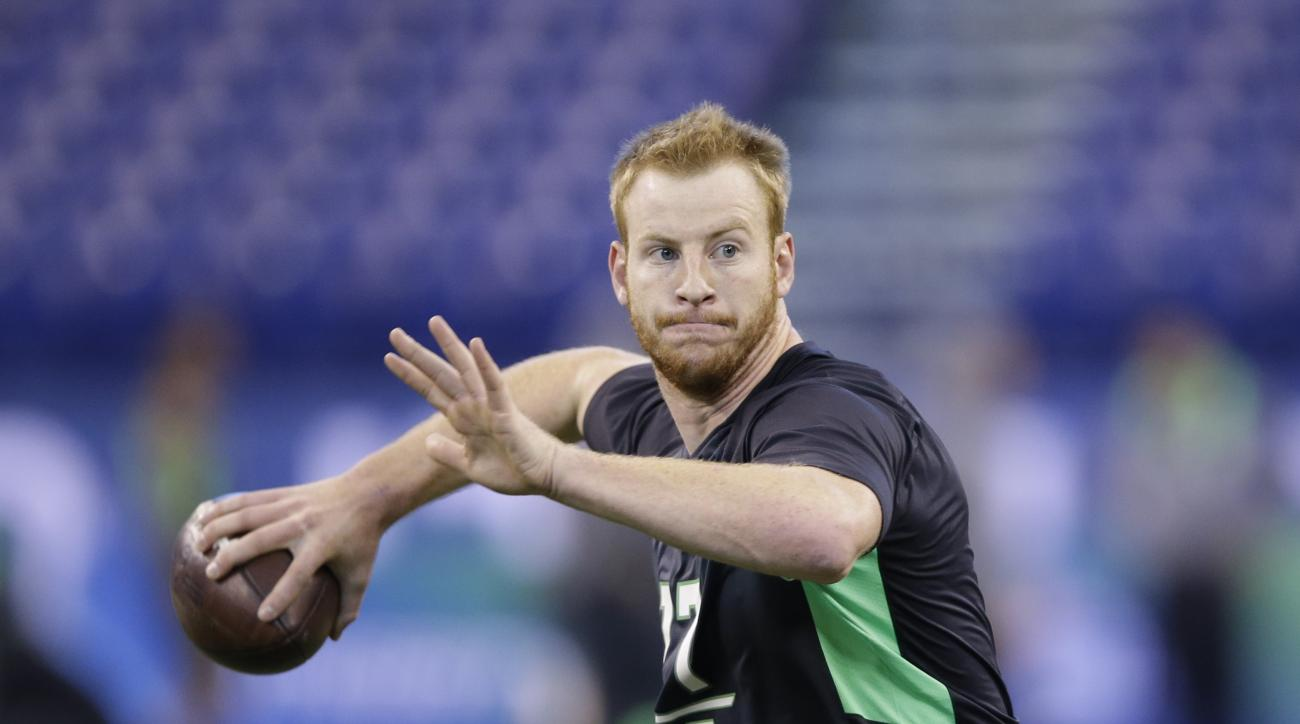 FILE - In this Feb. 27, 2016 file photo, North Dakota State quarterback Carson Wentz runs a drill at the NFL football scouting combine in Indianapolis. Even in a year when the quarterbacks don't appear to be slam-dunk naturals to make it big in the NFL, t