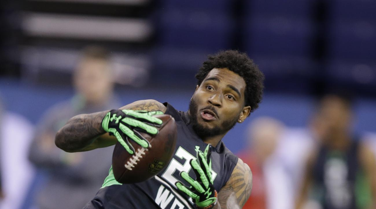 FILE - In this Feb. 27, 2016 file photo, Ohio State receiver Braxton Miller runs a drill at the NFL football scouting combine in Indianapolis. The facts about Miller's potential NFL career are clear: a transition from star quarterback at Ohio State to may
