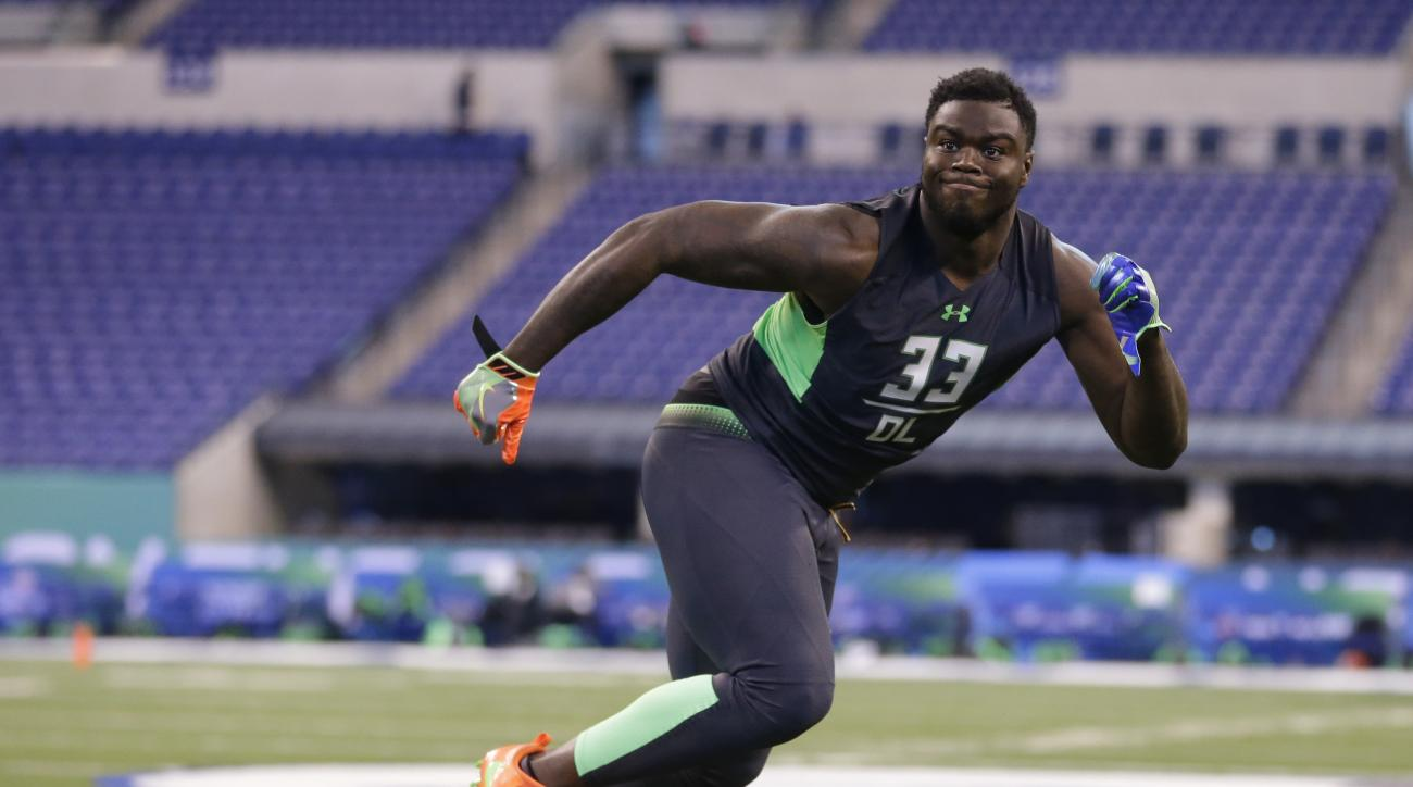 FILE - In this Feb. 28, 2016 file photo, Clemson defensive lineman Shaq Lawson runs a drill at the NFL football scouting combine in Indianapolis. (AP Photo/Michael Conroy, File)