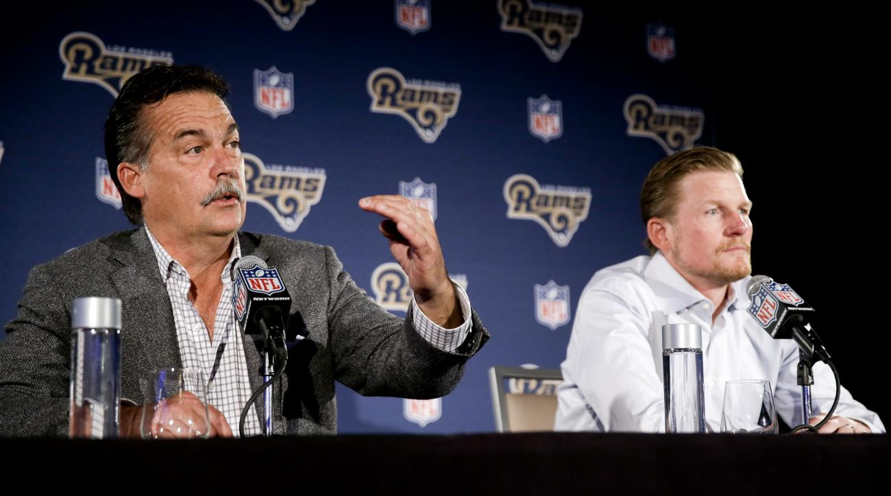 Los Angeles Rams general manager Les Snead, right, listens as head coach Jeff Fisher talk about their NFL draft process during a news conference in Los Angeles, Tuesday, April 26, 2016. (AP Photo/Chris Carlson)
