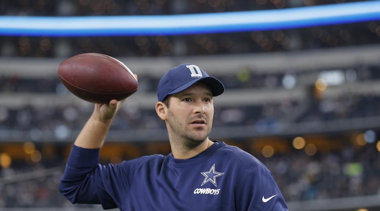 FILE - In this Nov. 1, 2015, file photo, Injured Dallas Cowboys quarterback Tony Romo tosses a football prior to the team's NFL football game against the Seattle Seahawks in Arlington, Texas. A fantasy football company partly owned by Romo is fighting the