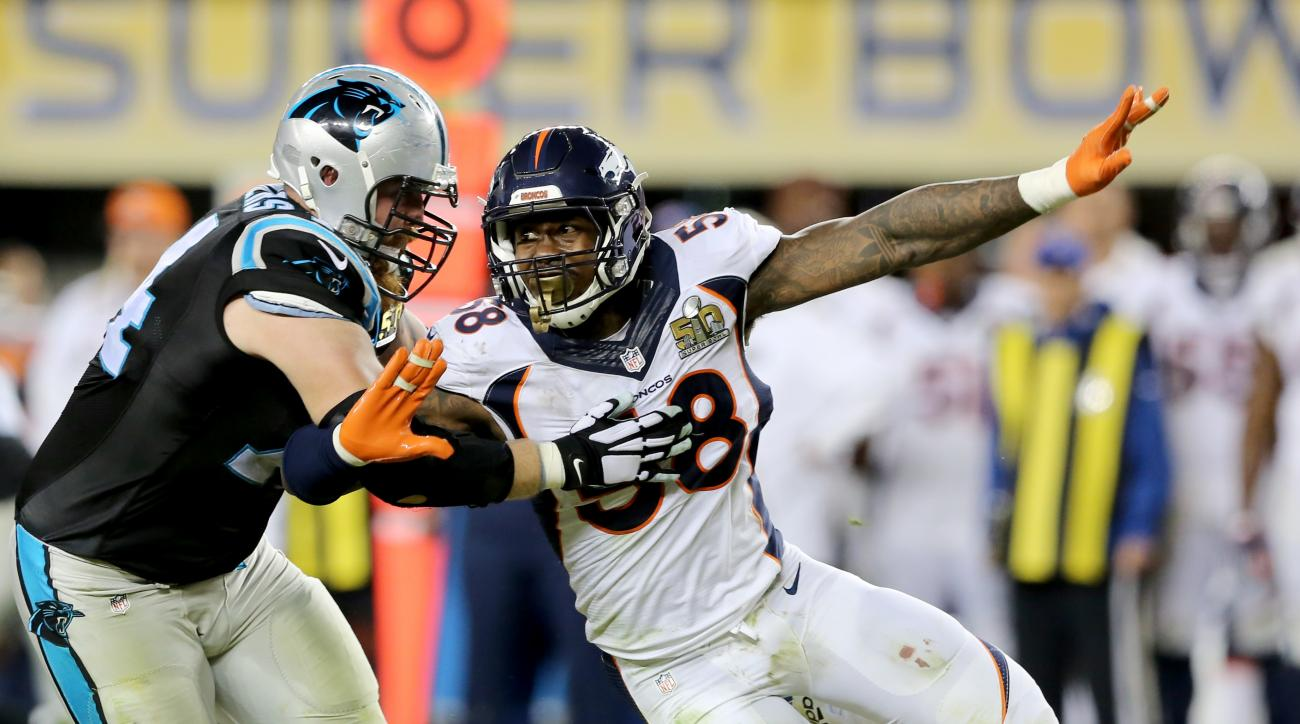 FILE - In this Sunday, Feb. 7, 2016 file photo, Denver Broncos Von Miller (58) makes an outside rush against the Carolina Panthers Mike Remmers (74) during the NFL Super Bowl 50 football game in Santa Clara, Calif.  Von Miller says he's optimistic hell so