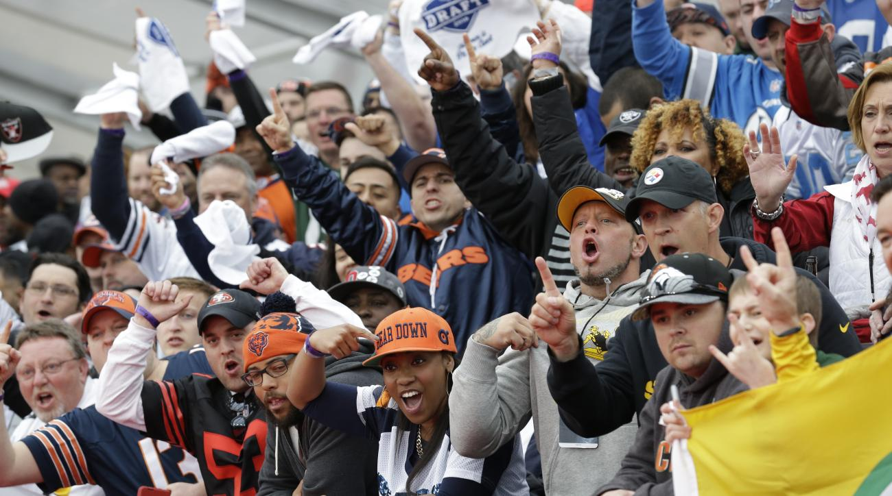 Fans cheer as they wait for the arrival of the draft prospects before the first round of the 2016 NFL football draft at the Auditorium Theater of Roosevelt University, Thursday, April 28, 2016, in Chicago. (AP Photo/Nam Y. Huh)