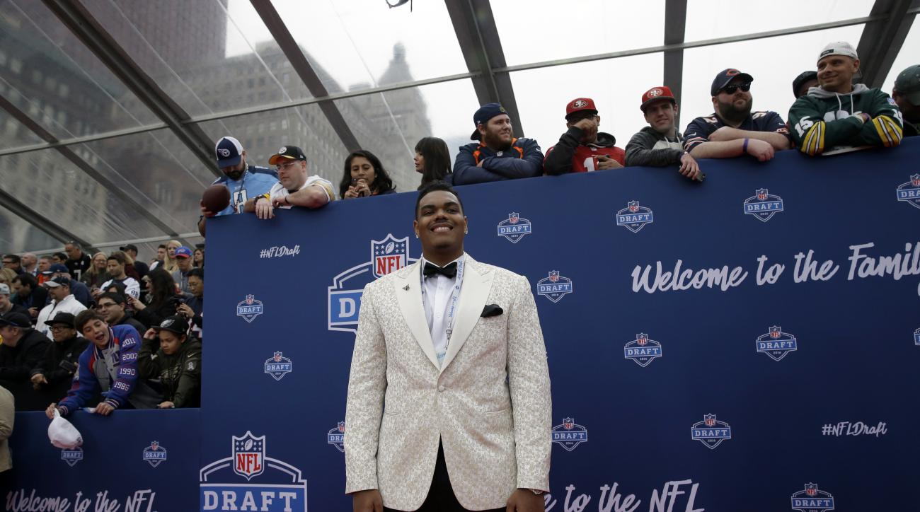 Notre Dames Ronnie Stanley poses for photos upon arriving for the first round of the 2016 NFL football draft at the Auditorium Theater of Roosevelt University, Thursday, April 28, 2016, in Chicago. (AP Photo/Nam Y. Huh)