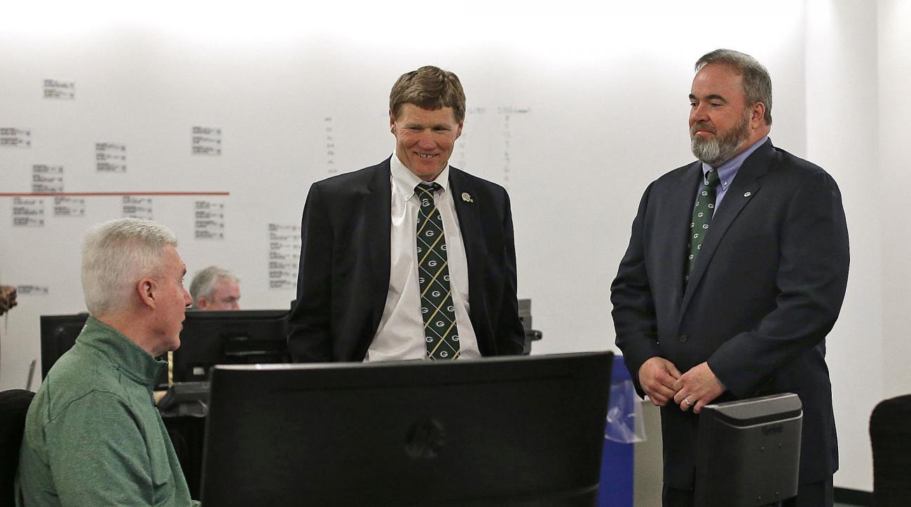 Green Bay Packers general manager Ted Thompson, left, president Mark Murphy, center, and head coach Mike McCarthy talk inside the war room during the 2016 NFL Football draft at Lambeau Field in Green Bay, Wis., on Thursday, April 28, 2016. (Evan Siegle/Th