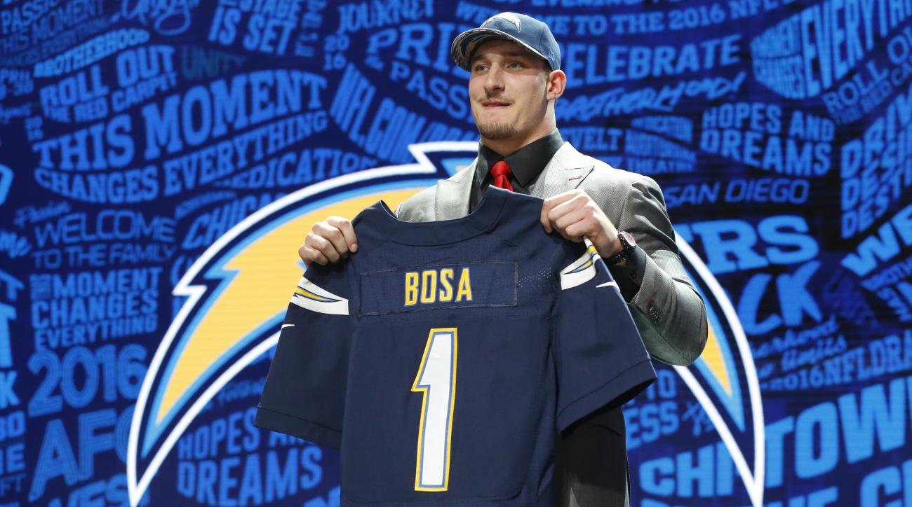 Ohio States Joey Bosa poses for photos after being selected by the San Diego Chargers as the third pick in the first round of the 2016 NFL football draft, Thursday, April 28, 2016, in Chicago. (AP Photo/Charles Rex Arbogast)