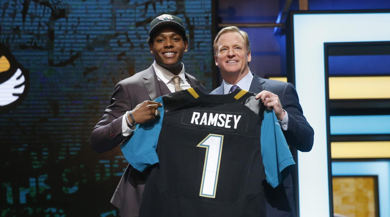 Florida States Jalen Ramsey poses for photos with NFL commissioner Roger Goodell after being selected by Jacksonville Jaguars as fifth pick in the first round of the 2016 NFL football draft, Thursday, April 28, 2016, in Chicago. (AP Photo/Charles Rex Arbo