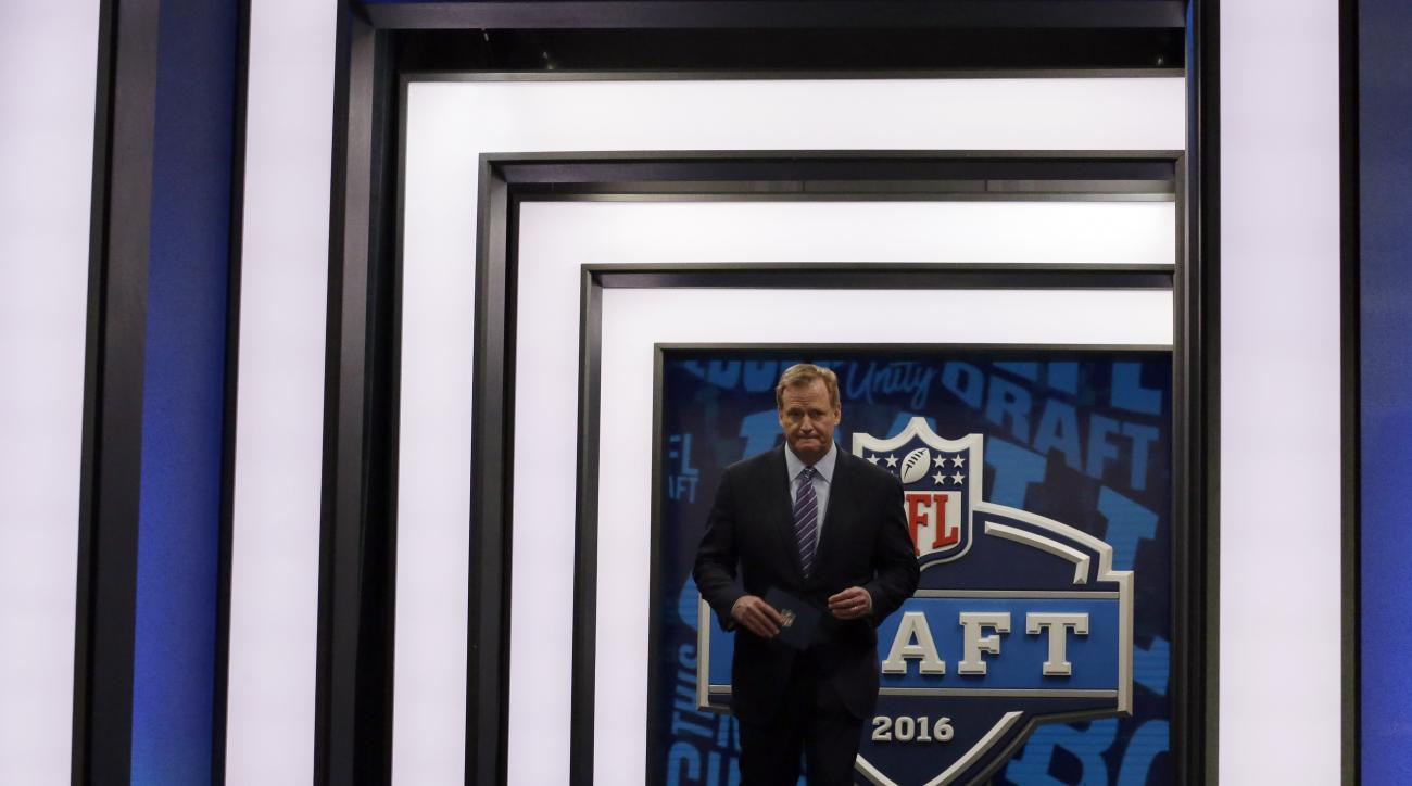 NFL commissioner Roger Goodell walks out to the stage during the first round of the 2016 NFL football draft, Thursday, April 28, 2016, in Chicago. (AP Photo/Nam Y. Huh)