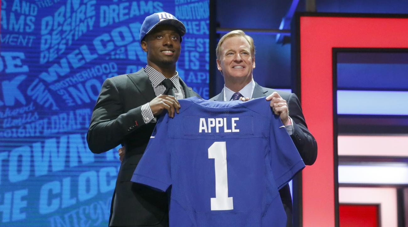 Ohio States Eli Apple poses for photos with NFL commissioner Roger Goodell after being selected by New York Giants as the 10th pick in the first round of the 2016 NFL football draft, Thursday, April 28, 2016, in Chicago. (AP Photo/Charles Rex Arbogast)