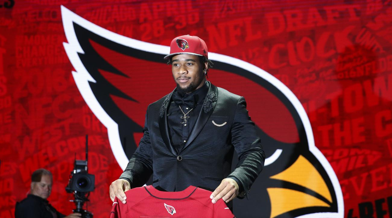 Mississippis Robert Nkemdiche poses for photos after being selected by the Arizona Cardinals as the 29th pick in the first round of the 2016 NFL football draft, Thursday, April 28, 2016, in Chicago. (AP Photo/Charles Rex Arbogast)