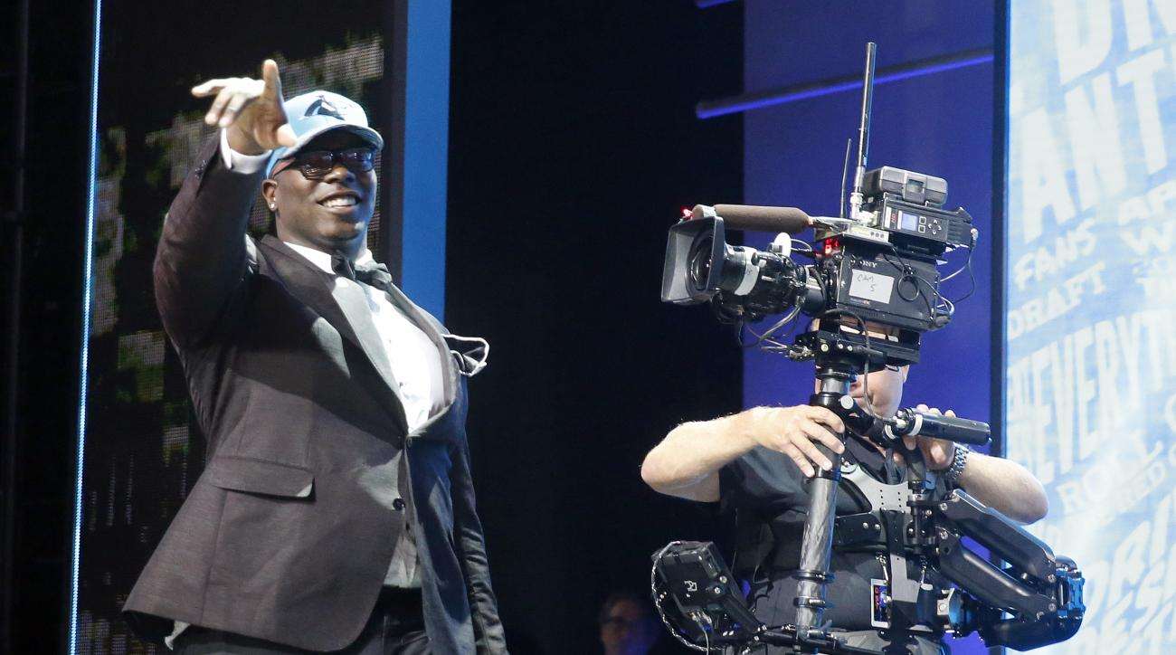 Louisiana Techs Vernon Butler walks on the stage after being selected by the Carolina Panthers as the 30th pick in the first round of the 2016 NFL football draft, Thursday, April 28, 2016, in Chicago. (AP Photo/Charles Rex Arbogast)