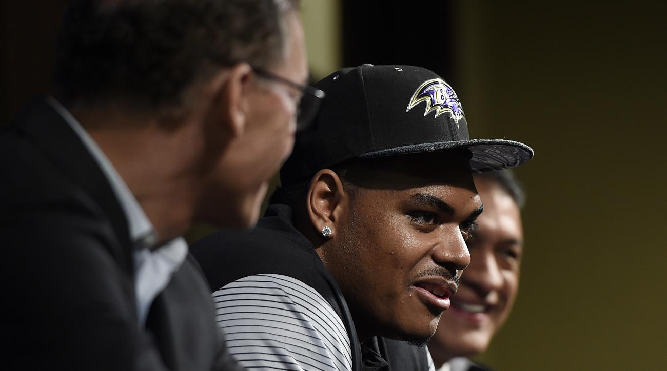 Baltimore Ravens first round draft pick Ronnie Stanley, center, smiles as he answers questions during a news conference Friday, April 29, 2016, in Owings Mills, Md. Also pictured, at left, is offensive coordinator, Marc Trestman and offensive line coach J