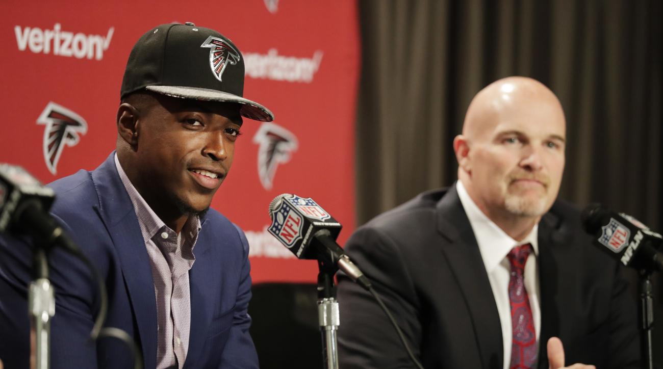 Atlanta Falcons first-round draft pick Keanu Neal, left, speaks at a news conference with head coach Dan Quinn at the football team's practice facility Friday, April 29, 2016, in Flowery Branch, Ga. (AP Photo/David Goldman)