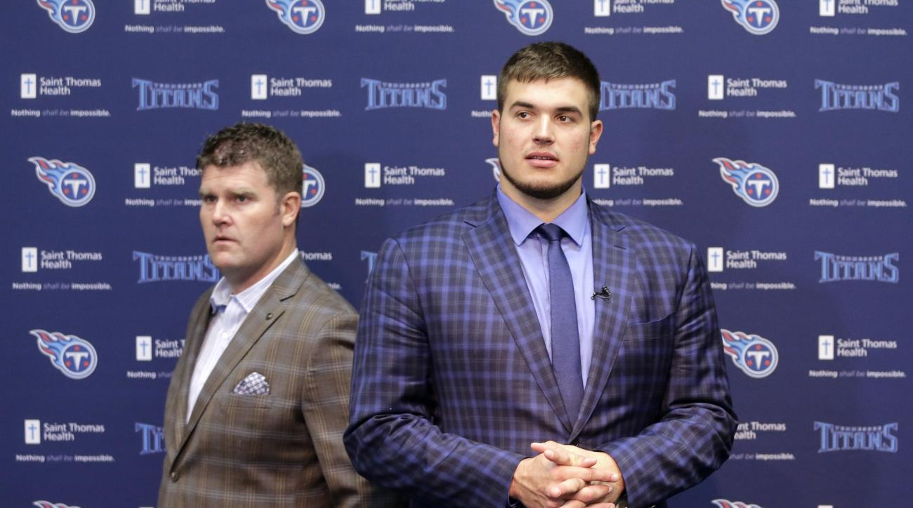 Michigan State offensive tackle Jack Conklin, right, the Tennessee Titans' top draft pick, arrives at a news conference with Titans' general manager Jon Robinson, left, on Friday, April 29, 2016, in Nashville, Tenn. (AP Photo/Mark Humphrey)