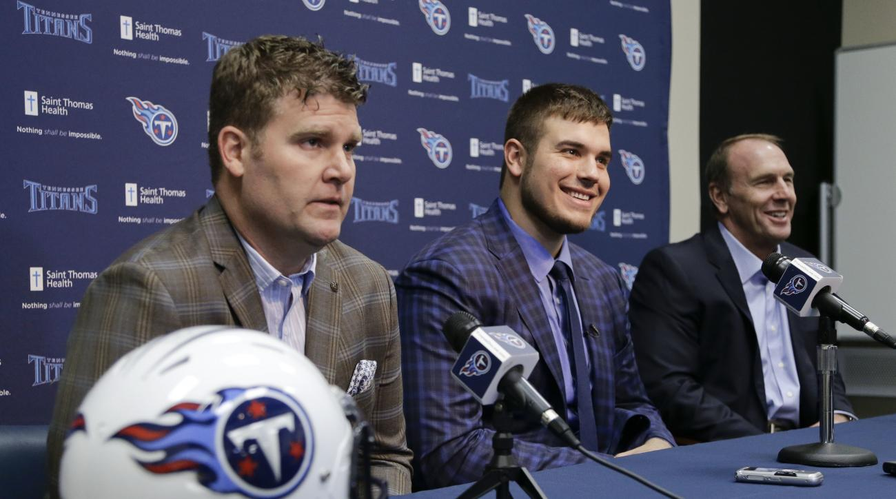 Michigan State offensive tackle Jack Conklin, center, the Tennessee Titans' top draft pick, appears at a news conference with Titans' general manager Jon Robinson, left, and head coach Mike Mularkey, right, on Friday, April 29, 2016, in Nashville, Tenn. (