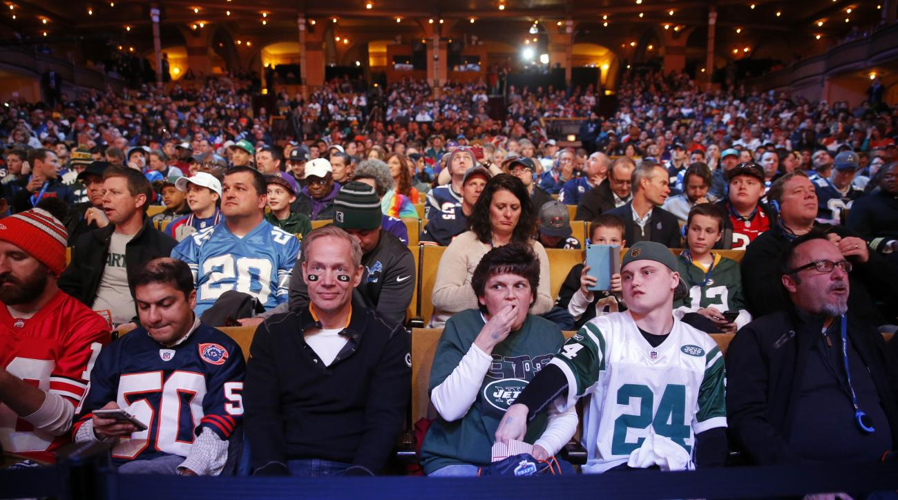 Fans wait for the second round of the 2016 NFL football draft at Auditorium Theatre of Roosevelt University,, Friday, April 29, 2016, in Chicago. (AP Photo/Charles Rex Arbogast)