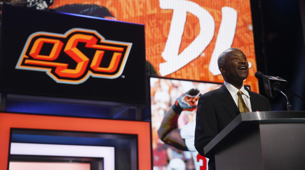 Former NFL player Paul Warfield announces that the Cleveland Browns selects Oklahoma States Emmanuel Ogbah as the 32nd pick in the second round of the 2016 NFL football draft, Friday, April 29, 2016, in Chicago. (AP Photo/Charles Rex Arbogast)