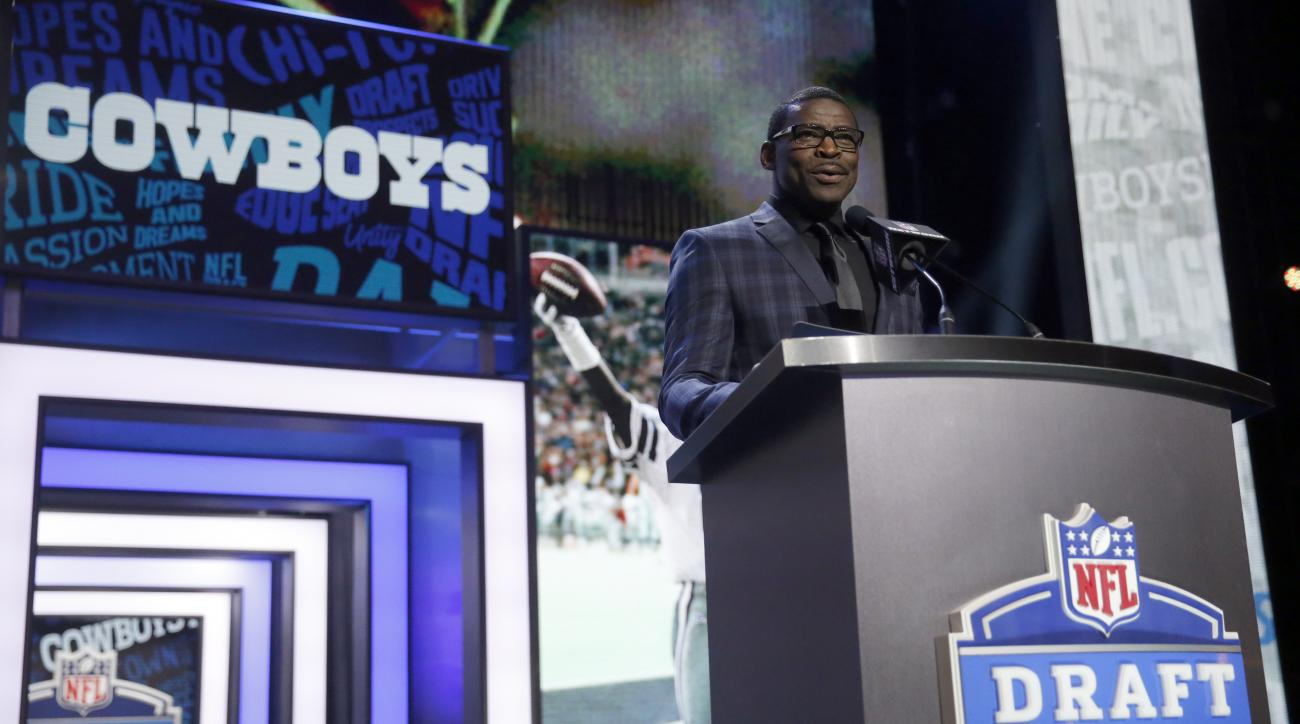 Former NFL player Michael Irvin announces that the Dallas Cowboys selects Notre Dames Jaylon Smith as the 34th pick in the second round of the 2016 NFL football draft, Friday, April 29, 2016, in Chicago. (AP Photo/Charles Rex Arbogast)