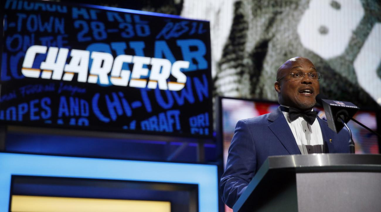 Former NFL player Gill Byrd announces that the San Diego Chargers selects Arkansas Hunter Henry as the 35th pick in the second round of the 2016 NFL football draft, Friday, April 29, 2016, in Chicago. (AP Photo/Charles Rex Arbogast)