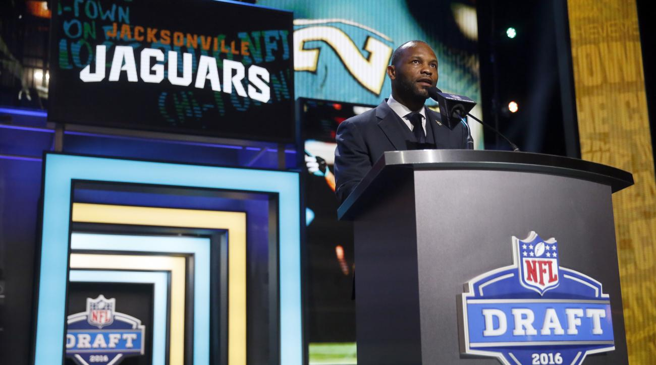 Former NFL player Fred Taylor announces that the Jacksonville Jaguars selects UCLAs Myles Jack as the 36th pick in the second round of the 2016 NFL football draft, Friday, April 29, 2016, in Chicago. (AP Photo/Charles Rex Arbogast)