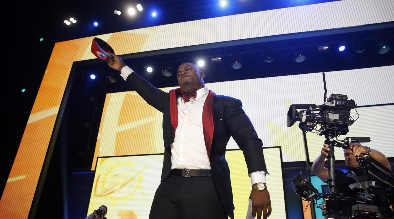 Mississippi States Chris Jones celebrates after being selected by the Kansas City Chiefs as the 37th pick in the second round of the 2016 NFL football draft, Friday, April 29, 2016, in Chicago. (AP Photo/Charles Rex Arbogast)